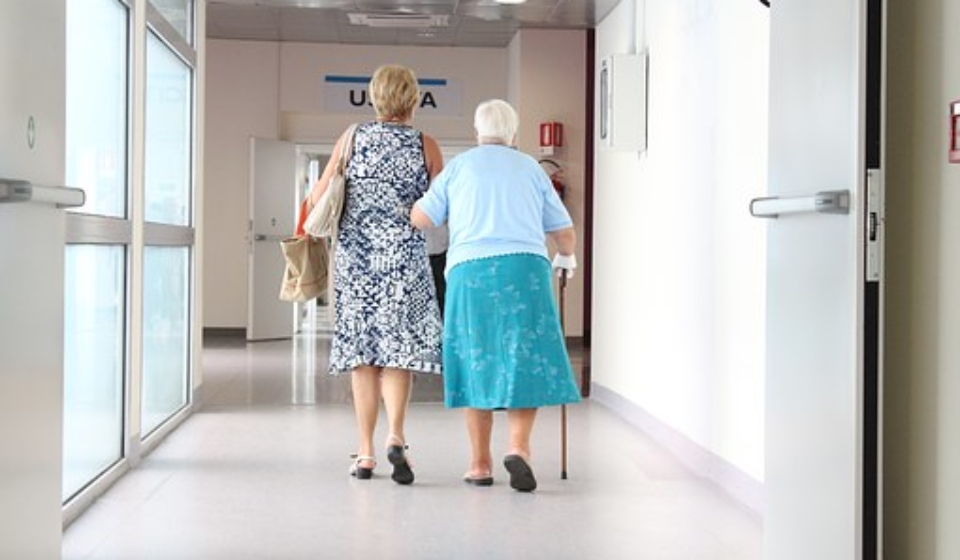 information about care homes hallway with 2 women