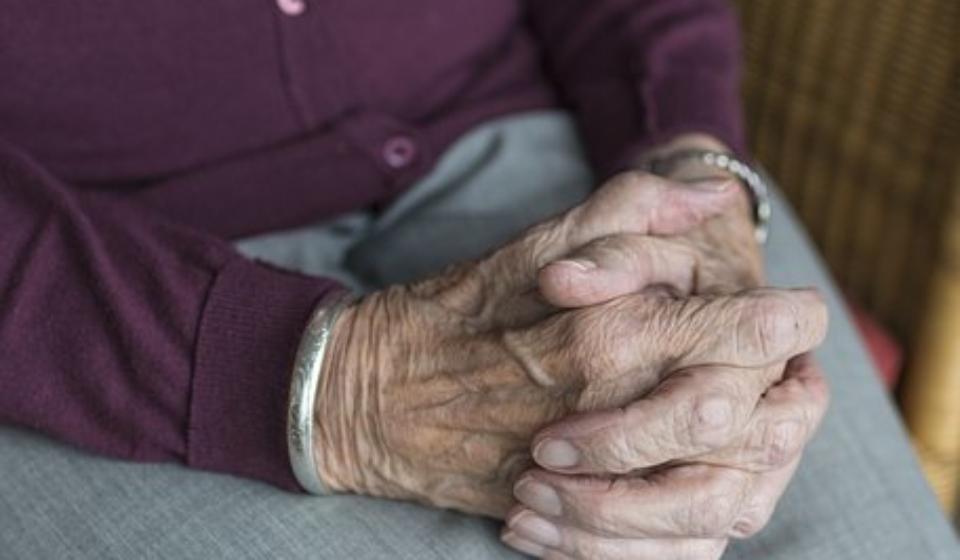 elderly people women with hands on lap